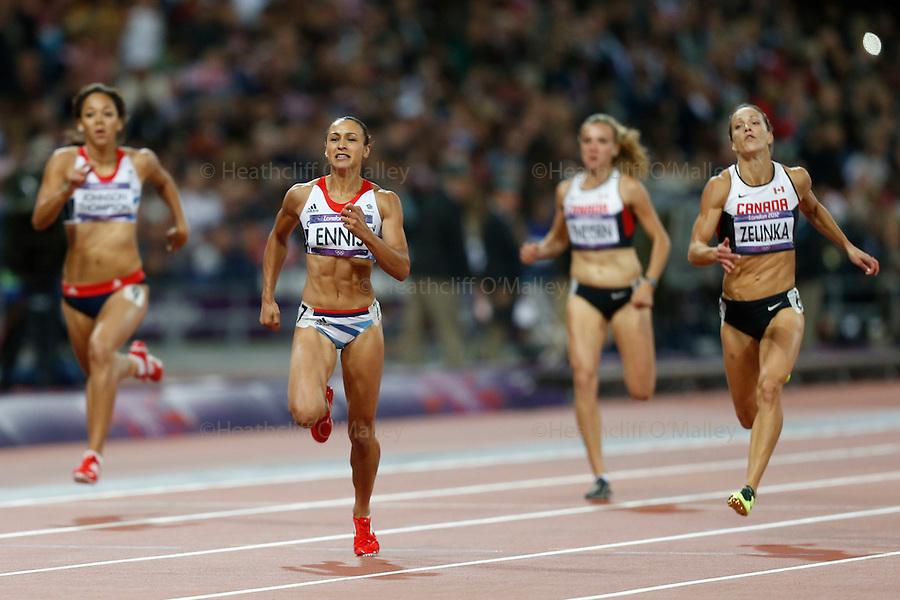 Mcc0041438 . Daily Telegraph..DT Sport..2012 Olympics..Team GB's Jessica Ennis wins her heat of the Heptathlon 200 meters . Ennis currently leads the Heptathlon after the opening four events..3 August 2012....