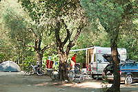 Corte, Corsica, France, September 2012. Camping Alivetu is located next to the restonica river at walking distance to town. Situated on a rock between the mountains at the confluence of several rivers, sits the city of Corte. Corte is a good base to explore the surrounding Restonica, Niolo and Tavignano valleys. Corsica is a wildly beautiful French island, scented with myrtle and possessing one of the most diverse landscapes in Europe, from crescent bays with white-sand beaches to montane forests sheltering rugged granite peaks, with miles of untouched coastline, sun-splashed mountain villages. Photo by Frits Meyst/Adventure4ever.com