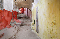 A stepped narrow street with colourful walls and archway in the medina or old town of Tetouan on the slopes of Jbel Dersa in the Rif Mountains of Northern Morocco. Tetouan was of particular importance in the Islamic period from the 8th century, when it served as the main point of contact between Morocco and Andalusia. After the Reconquest, the town was rebuilt by Andalusian refugees who had been expelled by the Spanish. The medina of Tetouan dates to the 16th century and was declared a UNESCO World Heritage Site in 1997. Picture by Manuel Cohen