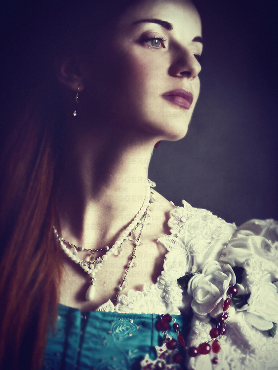 A portrait of a young woman in a period costume and a white pearl necklace, with a sentimental expression looking to one side