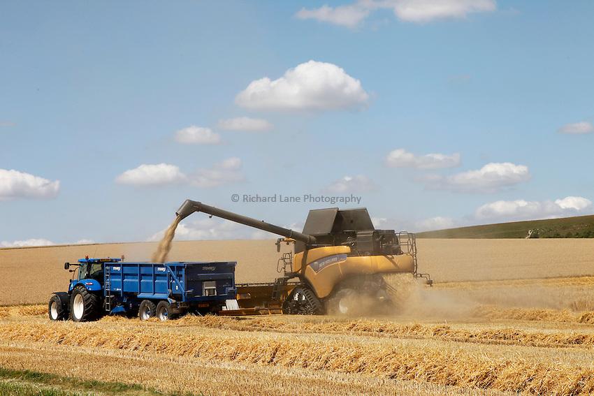 Photo: Richard Lane/Richard Lane Photography. New Holland combine harvester cutting winter barley near Devizes, Wiltshire. 22/07/2014.