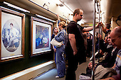 Moscow, Russia<br /> September 15, 2009<br /> <br /> Commuters on the Moscow metro have always been met with was the Palace of the People in interior design and architecture but now a days they are also met with museum pieces of art on the train to admire as they ride.