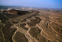 Aerials of the Nazca lines which are only visible from the air and form perfect geometric designs such as triangles and rectangles and straight lines running for several kilometers across the desert.  <br /> Some are animal shapes such as a monkey, a lizard, a condor--that are 90 to 180 meters long.  There is no proof but the most popular thought is that they were made by the Nazca and Paracas cultures during the period between 900 BC and 600 AD. Maria Reiche, a German mathematician who spent much of her life studying the lines considers the lines to be an astronomical calendar for agricultural purposes.  They are made by exposing lighter colored soil when sun-baked stones were moved and piled up.