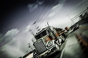 Editorial and commercial photo of semi truck on highway.