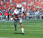 Auburn running back Tre Mason (21) scores against Mississippi at Vaught-Hemingway Stadium in Oxford, Miss. on Saturday, October 13, 2012. (AP Photo/Oxford Eagle, Bruce Newman)..