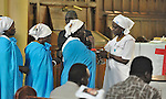 Participants celebrate communion during a worship service of Nuer refugees from South Sudan who live in Cairo, Egypt. The service took place at St Andrews United Church of Cairo.