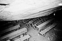 Benches sit under the collapsed ceiling of an 800-pupil school desroyed by the recent earthquake in Petionville, outside Port-au-Prince, Haiti.