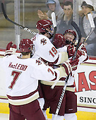 Isaac MacLeod (BC - 7), Chris Kreider (BC - 19), Tommy Atkinson (BC - 28) and Patrick Brown (BC - 23) celebrate Atkinson's goal.  The goal was Atkinson's first collegiate goal and Brown earned his first collegiate point with the primary assist. - The Boston College Eagles defeated the visiting University of Maine Black Bears 4-0 on Friday, November 19, 2010, at Conte Forum in Chestnut Hill, Massachusetts.