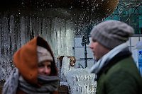 New York, United States. January 23, 2013. .People walk next to a fountain with ice during a cold Temperature under zero in New York City  -- . Photo by Eduardo Munoz Alvarez / VIEWpress.