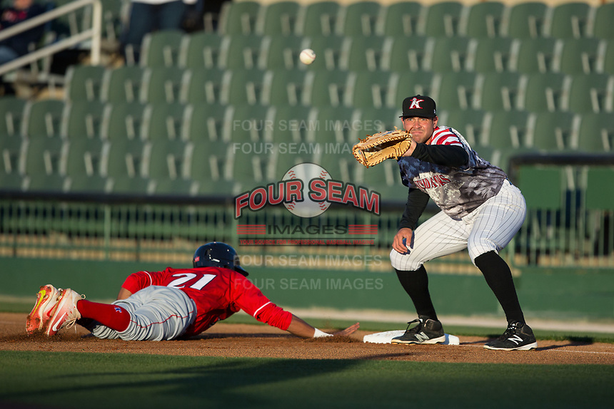 Brandon Dulin (31) of the Kannapolis Intimidators waits for a pick-off throw as Daniel Brito (21) of the Lakewood BlueClaws dives back towards first base at Kannapolis Intimidators Stadium on April 7, 2017 in Kannapolis, North Carolina.  The BlueClaws defeated the Intimidators 6-4.  (Brian Westerholt/Four Seam Images)