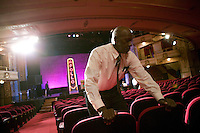13 February 2006 - New York City, NY - An employee checks the new seats at the Apollo theater in Harlem, New York City, USA, 13 February 2006. The famous theater, home of the Amateur Nights at The Apollo, is reopening with a renovated faade and new seats.