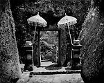 Gateway through volcanic rock into Gunung Kawi, one of Bali's oldest Hindu temples, on the alluvial slope below to Mt. Batur caldera.  Tampaksiring, Bali, Indonesia.