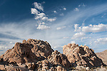 Indian Cove Campground, Joshua Tree National Park, Twenty Nine Palms, California; rock formations in late afternoon sunlight, with clouds in the background