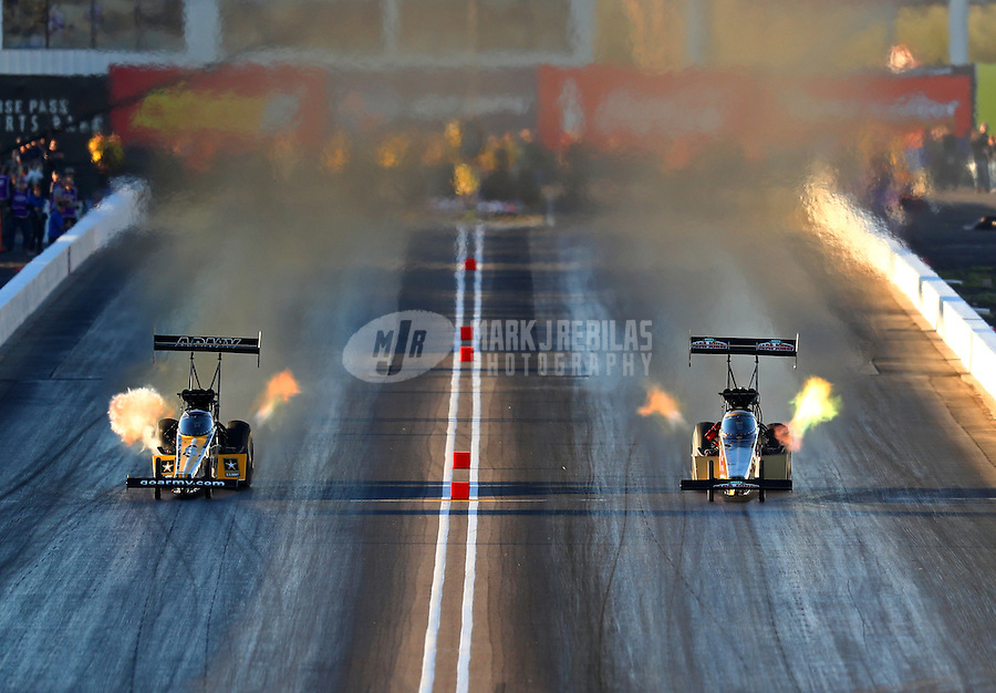 Feb 24, 2017; Chandler, AZ, USA; NHRA top fuel driver Leah Pritchett (right) races alongside teammate Tony Schumacher as she runs the quickest time in the history of the sport during qualifying for the Arizona Nationals at Wild Horse Pass Motorsports Park. Mandatory Credit: Mark J. Rebilas-USA TODAY Sports