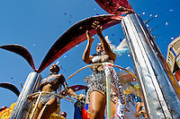 A Colombian girls perform on the top of the allegorical float during the Carnival in Barranquilla, Colombia, 27 February 2006. The Carnival of Barranquilla is a unique festivity which takes place every year during February or March on the Caribbean coast of Colombia. A colourful mixture of the ancient African tribal dances and the Spanish music influence - cumbia, porro, mapale, puya, congo among others - hit for five days nearly all central streets of Barranquilla. Those traditions kept for centuries by Black African slaves have had the great impact on Colombian culture and Colombian society. In November 2003 the Carnival of Barranquilla was proclaimed as the Masterpiece of the Oral and Intangible Heritage of Humanity by UNESCO.