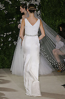 Model walks runway in a Barbara wedding dresses by Carolina Herrera, for the Carolina Herrera Bridal Spring 2012 runway show.