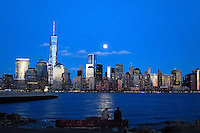 People watch the full moon as it rises over New York City from a park in New Jersey. March 15, 2014. Photo by Eduardo Munoz Alvarez/VIEW