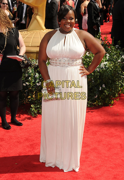 AMBER RILEY.62nd Annual Primetime Emmy Awards held at NOKIA Theatre Los Angeles, California, USA. .29th August 2010.full length white silver clutch bag dress hand on hip  .CAP/ADM/BP.©Byron Purvis/AdMedia/Capital Pictures.