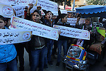 Palestinians take part in a protest demanding release the prisoners in Israeli jails, in front of Red cross office, in Gaza city, on Dec. 07, 2015. Photo by Mohammed Asad