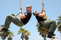 "Santa Monica Police Officer Scott McGee (left) and Sergeant Greg Smiley climb a 15-foot rope a Santa Monica Muscle Beach during  CrossFit's ""Hero Workout,"" in honor former SMPD Officer and Marine Rick Crocker on Thursday, May 26, 2011. Crocker was killed six years ago today while serving in Iraq. The ""Hero Workout of the Day"" is named after those who have given their lives in the line of duty."