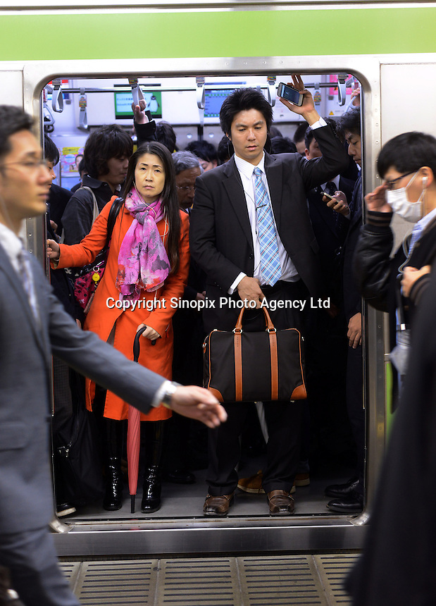 Passengers packed on a train in Shinjuku Station, Tokyo, Japan. With up to 4 million passengers passing through it every day, Shinjuku station, Tokyo, Japan, is the busiest train station in the world. The station was used by an average of 3.64 million people per day.  That&rsquo;s 1.3 billion a year.  Or a fifth of humanity. Shinjuku has 36 platforms, and connects 12 different subway and railway lines.  Morning rush hour is pandemonium with all trains 200% full. <br /> <br /> Photo by Richard jones / sinopix