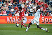 Chicago midfielder Sebastian Grazzini (10) takes a shot in front of Toronto defender Andy Iro (3).  The Chicago Fire defeated Toronto FC 2-0 at Toyota Park in Bridgeview, IL on August 21, 2011.