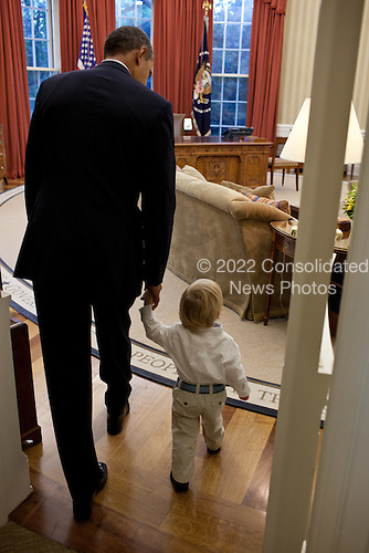 United States President Barack Obama walks into the Oval Office with William Jones, son of Luke Jones, Presidential Personnel Office, before a departure photo with the Jones family, September 29. 2011. .Mandatory Credit: Pete Souza - White House via CNP