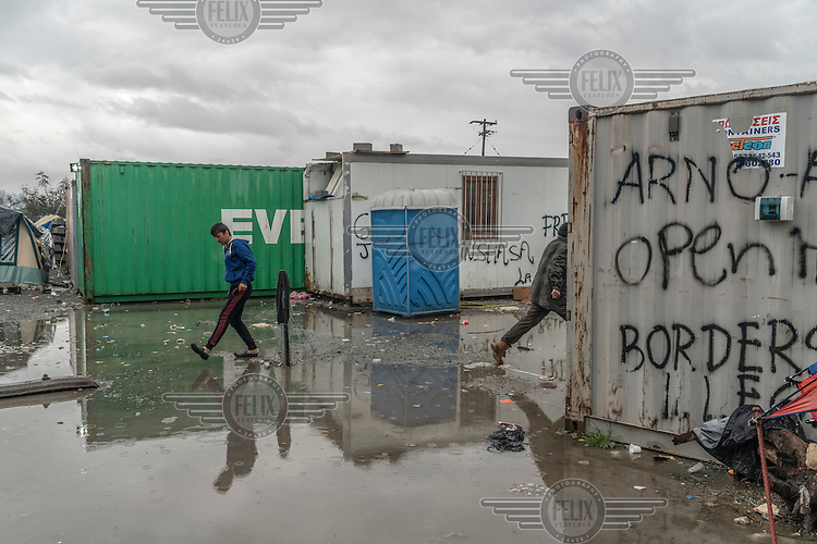 Refugees negotiate the flooded refugee camp in Idomeni that has developed after Macedonia decided to close its border with Greece, blocking all refugees from passing and making their way North.