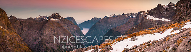 Milford Sound as seen in distance  from Gertude Saddle at dawn, Fiordland National Park, UNESCO World Heritage Area,  Southland, New Zealand, NZ
