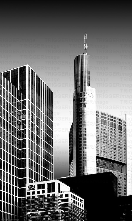 The tower of the Commerzbank between office buildings in Frankfurt.