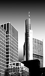The tower of the Commerzbank between office buildings in Frankfurt.