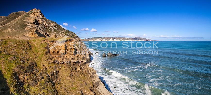 Panorama - Surf waves & cliffs - Mahia Peninsula, Hawkes Bay. North Island New Zealand.