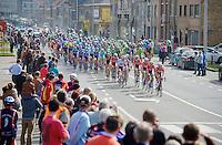 peloton riding through Diksmuide<br /> <br /> Gent-Wevelgem 2014