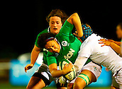 27.02.2015. Ashbourne Rugby Club, Ireland. Womens 6-Nations international. Ireland versus England. Sophie Spence (Ireland) attempts to get through the tackle of Rochelle Clark (England).
