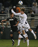 Michael Thomas #8 of Notre Dame heads clear from Gabriel Hernandez #11 of Oakland. The University of Notre Dame defeated Oakland University 2-1 in the second round of the NCAA championship at Alumni Field at the University of Notre Dame in South Bend, Indiana on November 28, 2007.