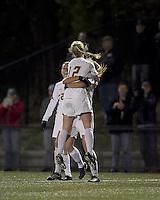 "Boston College midfielder Julia Bouchelle (12) celebrates her goal with teammates. Boston College defeated West Virginia, 4-0, in NCAA tournament ""Sweet 16"" match at Newton Soccer Field, Newton, MA."