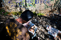 "A Honduran immigrant browses through a US porn magazine while waiting near the railroad track to climb up the cargo train known as 'La Bestia' (The Beast) in Lechería station, in the outskirts of Mexico City, Mexico, 6 November, 2014. Between 2010 and 2015, the US and Mexico have apprehended almost 1 million illegal immigrants from El Salvador, Honduras, and Guatemala. While the economic reasons remain the most frequent motivation for people from Central America to illegally immigrate to the US, thousands of Salvadorans, Guatemalans, and Hondurans, many of them minors, seek asylum in the US due to the thriving crime and gang-related violence in their region (known as the Northern Triangle). Taking an exhausting and risky journey, riding thousands of miles atop the cargo trains, facing a physical danger and extortion from the organized crime groups that control migrant routes, the ""undocumented"" still flee to the US, looking for their American dream."