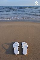Woman's sandals on beach (Licence this image exclusively with Getty: http://www.gettyimages.com/detail/83154265 )