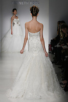 Model walks runway in a Milana wedding dresses by Amsale Aberra, for the Kenneth Pool Spring 2012 Bridal runway show.