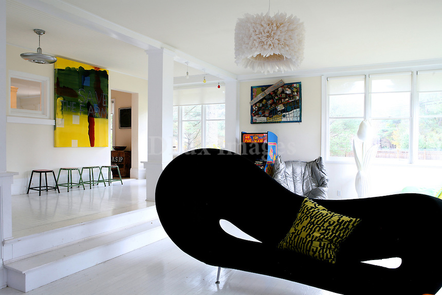 Architect Bob Novogratz  has made a career of restoring old, run down New York townhouses and creating contemporary urban homes.  ..Seeking a country family retreat to get away from the hustle and bustle of New York City, Novogratz found this old home in rural Massachusetts and transformed it into a contemporary refuge for the family.  Colorful furnishings and decor mix with contemporary art to create an eccentric but comfortable environment..