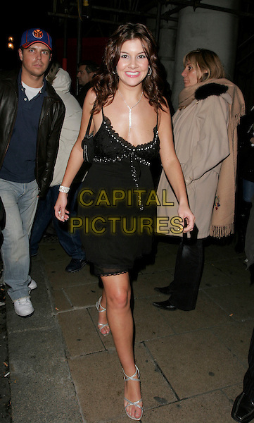 IMOGEN THOMAS - BIG BROTHER.At the OK! Magazine Christmas Party, Jewel, Piccadilly, London, UK. .December 5th 2006.full length dress black.CAP/AH.©Adam Houghton/Capital Pictures