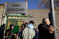 Italy. Lombardy region. Milan. A free food distribution takes place daily at the lay association: Pane Quotidiano. People queue on line and wait outside before the morning openig. Thousands of people receive daily bread, milk, yoghurt, vegetables, fruits,.. 19.03.13 © 2013 Didier Ruef