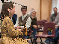 NWA Democrat-Gazette/ANTHONY REYES @NWATONYR<br /> Julia Stilwell, 9, sings and uses a dancing dall Wednesday, March 15, 2017 at the Shiloh Museum of Ozark History in Springdale. Julia and the other singers from the Shiloh Balladeers performed songs like &quot;Skip to My Lou,&quot; &quot;Bangum and the Boar&quot; and &quot;The Dewy Dens of Yarrow&quot; which all link back to the Ozarks, though they may have long histories.