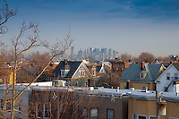 Manhattan view with skyscrapers through the roofs of New Jersey townhouses