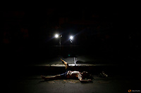 Lights from TV cameras lit the body of a man killed by unknown gunmen in Manila, Philippines early October 24, 2016. REUTERS/Damir Sagolj