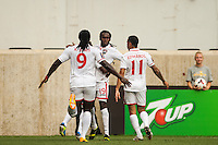 Trinidad and Tobago midfielder Keon Daniel (19) celebrates scoring with forward Kenwyne Jones (9) and defender Carlos Edwards (11). during a CONCACAF Gold Cup group B match at Red Bull Arena in Harrison, NJ, on July 8, 2013.