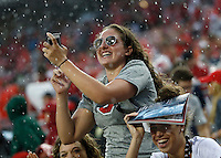 Fans get wet during the second quarter of the NCAA football game between the Ohio State Buckeyes and the Tulsa Golden Hurricane at Ohio Stadium on Saturday, September 10, 2016. (Columbus Dispatch photo by Jonathan Quilter)