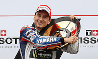 Yamaha MotoGP rider Jorge Lorenzo of Spain celebrates with his trophy after winning the 2013 Australian Motorcycle Grand Prix in Phillip Island, Oct 20, 2013. Photo by Daniel Munoz/VIEWpress IMAGE RESTRICTED TO EDITORIAL USE ONLY- STRICTLY NO COMMERCIAL USE.