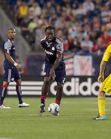 New England Revolution midfielder Shalrie Joseph (21) passes the ball. The New England Revolution tied Columbus Crew, 2-2, at Gillette Stadium on September 25, 2010.