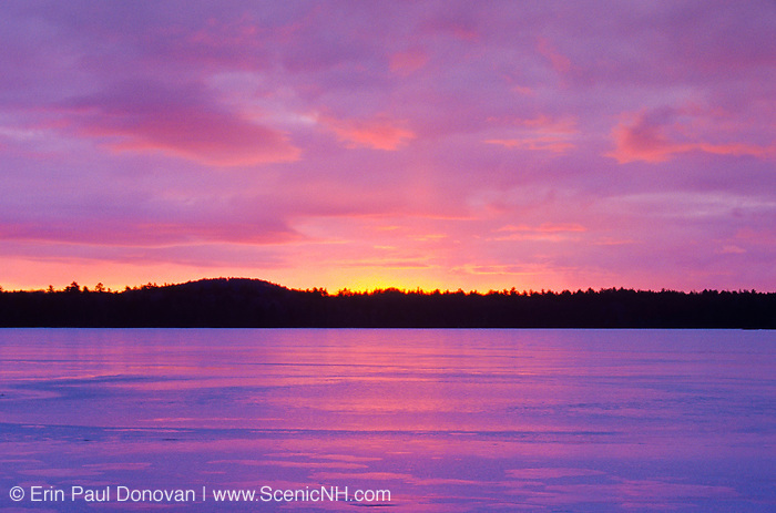 Sunset over Lake Massabesic in Auburn, New Hampshire USA during the winter months